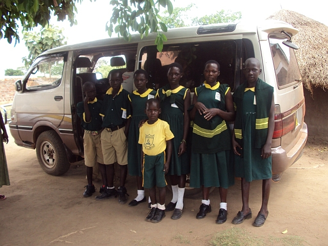 Pupils waiting to board mini bus to school